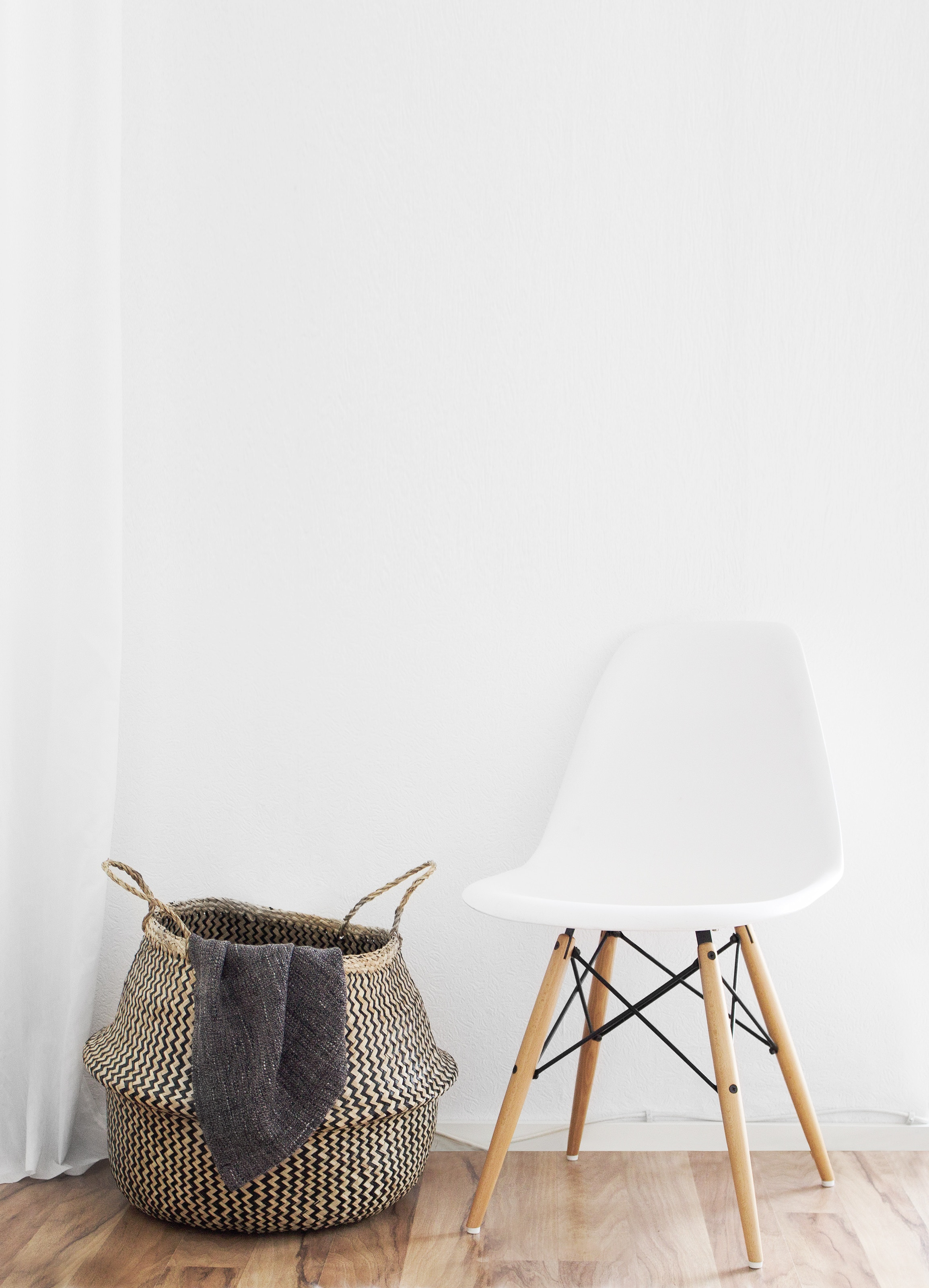 Chair & Basket in Room With White Walls